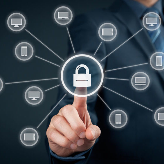 44008118 - information technology devices security concept. businessman click on button with padlock linked to it devices (pc, notebook, tablet, mobile phone).